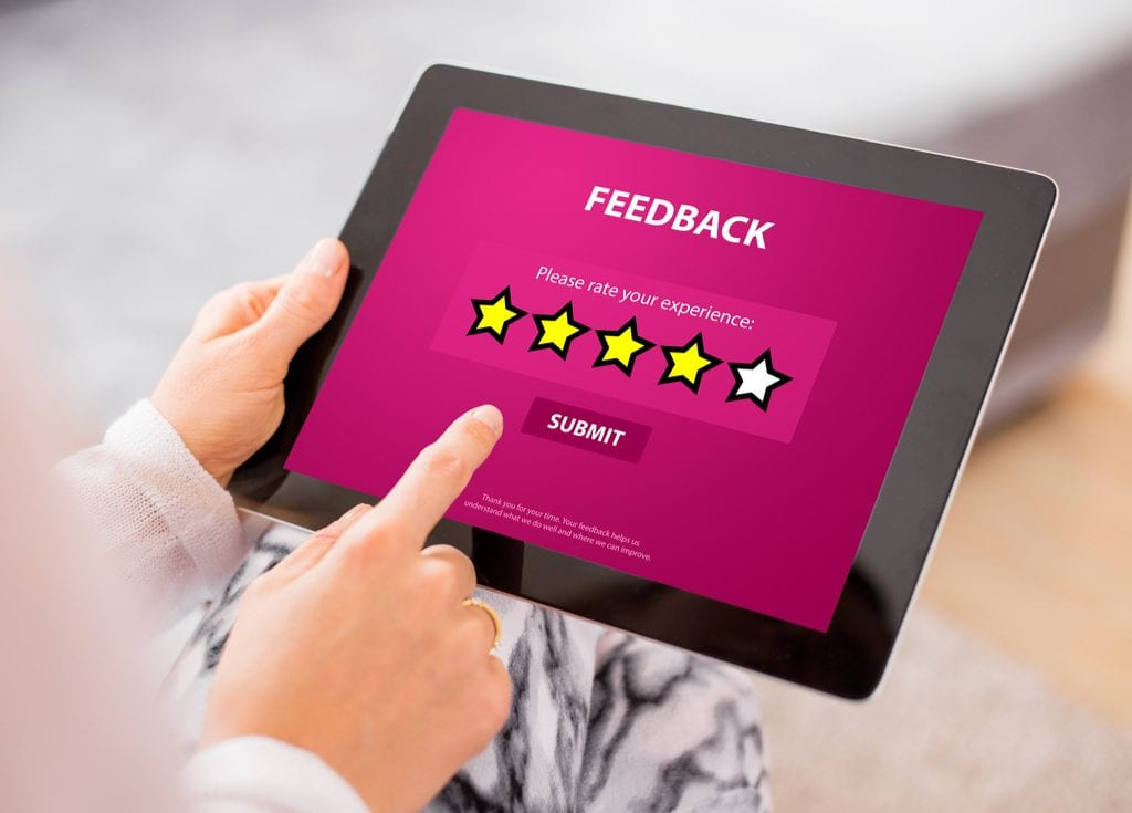 Image of ipad survey for how to get patient reviews